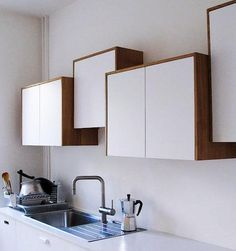Discovered (and admired) via the Improvised Life: off-kilter cabinets in a kitchen by Belgian architects Lhoas & Lhoas.