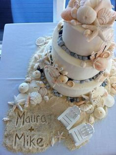 "The names in the ""sand""-- such a nice touch! Love this beach wedding cake"