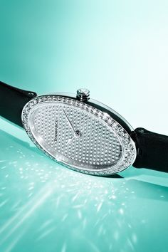It's Christmas time. Tiffany Cocktail 2-Hand 21 x 34 mm watch in 18k white gold with pavé diamonds.