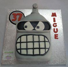 Futurama fue una serie animada para adultos . Bender es un robot pero actúa como humano y tienes unas características que…mejor ni mencionarlas! La tarta en fondant de Bender, con un interior de chocolate, relleno de nata y trufa y embebido con almíbar al brandy.  ¡Llámanos al 616849394, tenemos el mejor precio de Málaga! www.depaulapasteleria.blogspot.com www.facebook.com/panaderiadeliziasdepaula www.tartasmalaga.net