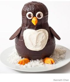 Easy penguin cake from Parenting Magazine http://www.parenting.com/article/how-to-make-a-penguin-birthday-cake?viewFull=true#comments