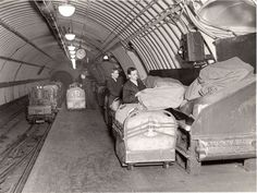 Workers loading mail sacks onto Mail Rail 1935 photo The Postal Museum and Mail Rail Old London, London City, London Underground Train, Tube Train, Hidden Art, Museum Store, Historical Images, Train Rides, Post Office