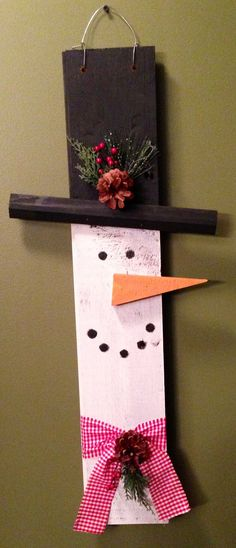 This is a handman snowman. He is made from old barn wood. The barn was built in the early 1900s. We recycled a bunch of stuff that came out from it