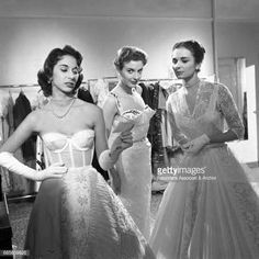 December 31, 1954   Italian actresses Madeleine Fisher, Anna Maria Pancani, Eleonora Rossi Drago (Palmira Omiccioli) discussing about the fashion house they just opened in Turin in the film 'The Girlfriends', (Le Amiche) directed by Michelangelo Antonioni. Italy, 1955 (Getty Images)