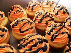Tiger Cupcakes - white cake, orange frosting, chocolate drizzle