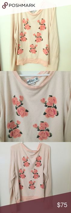 Floral Wildfox top Floral design with a base color of pastel pink. Thin long sleeves top with a material warm enough to wear on a mild windy day! Cute to wear with jeans or leggings and is super comfortable  Wildfox Sweaters Crew & Scoop Necks