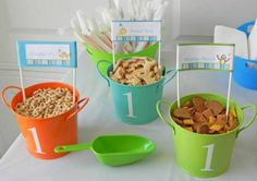 Boy First 1st birthday party decoration & food ideas - zoo theme - snacks in colorful tins w/ food labels