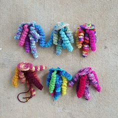 six crochet jellyfish bases with hyperbolic crochet tentacles