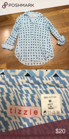 Geometric blue and navy tunic Super cute tunic with pockets and sleeve can be rolled up and buttoned! Flowy and cute- looks adorable with dark jeans! Size medium but would also fit large Tops Tunics