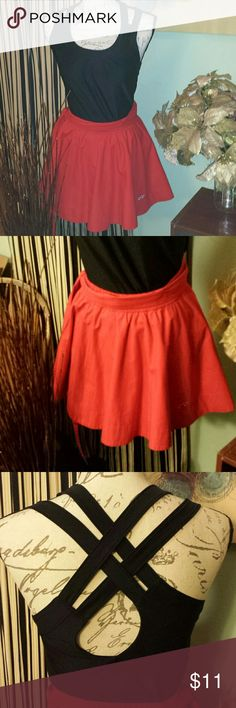 CLEARANCE 2/$10 Bundle skirt & Athletic top Recieve both pieces in this bundle. Red Hollister stretchy waist cheerleader skirt sz small. Black athletic tank top by reactivated sz XS.   GET THIS BUNDLE FOR $5 WHEN BUNDLED WITH ANOTHER item. Otherwise price is firm on items under $10 Hollister Skirts Midi
