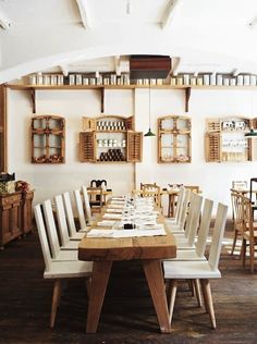 Restaurant LACrimi Si Sfinti, Remodelista - mixing Romanian folk design and modern. Window frames from an abandoned cottage on the wall add interest.