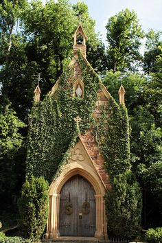 Church- St. Catherine's at Bell Gable in Fayetteville, Arkansas built in 1990s, setting for weddings- stone with ivy