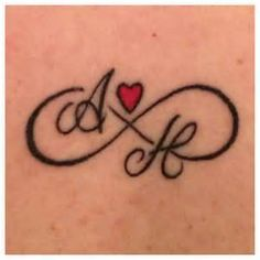 infinity symbol tattoo sisters - -with her initials in her handwriting