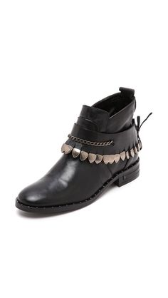 These are Freda Salvador Star Booties. It is easy to make a bracelet around your existing booties to give an upgrade. If you have more time, buy a piece of leather and copy this whole idea and tie the whole thing from the back. Saves a lot of money!