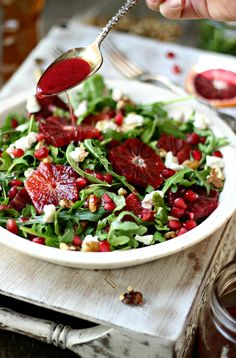 Arugula, Blood Orange & Honey Goat Cheese Salad with Pomegranate Vinaigrette