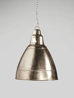 "the simple farmhouse pendant light gets an upgrade in the nickel plated canary pendant. polished nickel adds shine and poise to any island, bath, vanity or kitchen space. a terrific, timeless option to stylishly light up any room in the house. includes canopy + chain dimensions: 18""d x 18""l x 23""h"