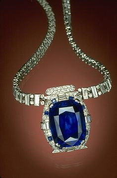 'The Bismarck Sapphire' named for Countess Mona von Bismarck who owned the 98.6 carat Sri Lankan sapphire, purchased during visit to Sri Lanka in 1926; one stopover of her worldwide honeymoon cruise with millionaire husband Harrison Williams - deep cornflower blue cushion-cut - In 1967 Cartier re-cut/reset the stone as a pendant to a unique diamond and platinum necklace. The countess then donated it to the Smithsonian, now displayed in the Gem Gallery at the National Museum of Natural…