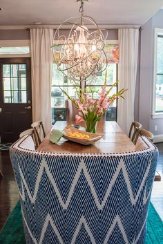 A colorful, chic breakfast room featuring navy / white ikat wingback end chairs and a teal rug. Accessories from HomeGoods complete this beautiful space! Sponsored by HomeGoods. Dining Room Table, Dining Area, Dining Rooms, Light Grey Walls, Gray Walls, Condo Living Room, Cool Chairs, Elegant Homes, Elle Decor