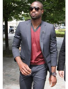Dwayne Wade, 2011  A simple suit and v-neck make room for stylish accessories: sunglasses, lapel pin, and big ole watch. http://www.PaulFDavis.com image consultant (info@PaulFDavis.com) life coach for wellness.
