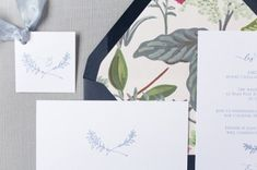 "This delicate indigo stationery suite was created around a beautiful hand-drawn laurel by Andrea Stimson of Fig & Flourish Calligraphy. It is no surprise that her flowing hand shows up on the envelopes as well! Envelopes are lined with ""Herb Garden"" by Rifle Paper Co., a gorgeous accent to the navy script. See this & more at www.beccamercer.com (Photo: Sami Kathryn) #weddinginvitationsuites  #fullsuite #silkribbon #marsala #rsvp #infocard #weddinginvitation #navy #gardenwedding #laurel…"