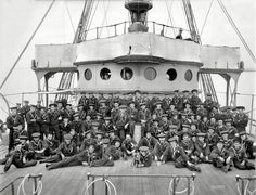 """Circa 1900. """"U.S.S. Buffalo, ship's company."""" A certain amount of mugging for the camera here, as well as various props and a canine mascot. 8x10 inch dry plate glass negative by Edward Hart, Detroit Publishing Company. Shorpy Historical Photo Archive :: Buffalo Pup: 1900"""