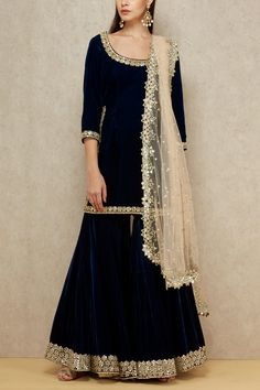 Abhinav Mishra exemplifies grandeur making them a perfect companion for your festive look featuring a navy velvet kurta with an embellished neckline paired with sharara bottoms and beige dupatta. Style the look with a gold jadau choker and danglers set. Pakistani Dresses Casual, Pakistani Dress Design, Casual Dresses, Dress Outfits, Fashion Dresses, Velvet Pakistani Dress, Wedding Outfits, Wedding Dresses, Sharara Designs