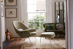 "Reception room. Berber rug. Eero Saarinen ""Womb Chair"" in custom fabric by Knoll. Italian framed screen prints.  Vintage french wine vessel."