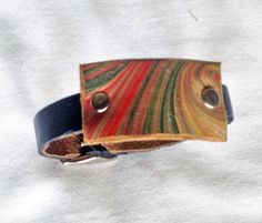 #handmade #leather accessories on Etsy This leather wrist #cuff is handmade using leather remnants, repurposed, recycled but new pieces of leather I purchase by the pound. Every piece is #unique, and that is how I... #trending #etsy #jewelry #bracelet #remnant #bracelet #lined #women #green #marbled #accessory #sfetsy