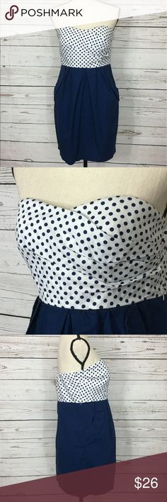 "BCX Polka Dot Strapless Dress w/Pockets Adorable navy blue and white polka dot dress with pockets and a back zipper. Bust: 30"" (the top of the back is elastic and will stretch several inches); length in the back from under the arm to the bottom hem: 24 1/2"". Measurements are approximate. Smoke free home. 🌺Thanks for shopping my closet 😊🌺 BCX Dresses Strapless"
