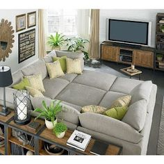 love how comfy this living room looks.  also like all the plants -- too bad mine would all die.