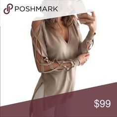 Long sleeve high low shirt Limited quantities available, lightweight long sleeve shirt with cut out details on sleeves. Front of shirt is shorter than back for high low look. Perfect shirt for layering under your favorite jacket or vest. boutique Tops Blouses