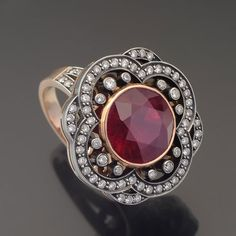 ring in rubies and diamonds. This would be lovely with seed pearls.