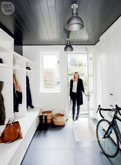 A once tiny starter house becomes a family's dream home With a cubby for each family member along one wall and meticulously laid-out closets on the other, the mud room is an ultra-organized treat for the active family. Mudroom Laundry Room, Laundry Room Design, Laundry Decor, Style At Home, Starter Home, Home Fashion, Built Ins, Home Staging, Sweet Home