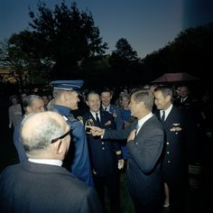 Kennedy joking with the Joint Chiefs.