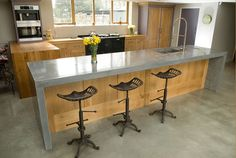 wooden kitchen with concrete worktop from lovewoodfurniture.co.uk  Stick to light-to-mid shades (with a matt finish) and simply think of it as you would any other neutral colour when pairing it with other colours.""
