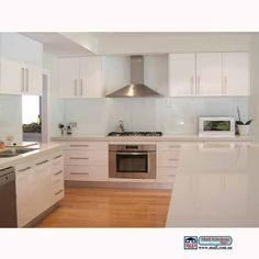 White kitchen, with timber floor, this sort of result can be achieved in our kitchen, we can do the same with the wall in our kitchen Timber Kitchen, White Kitchen Backsplash, Glass Kitchen, Kitchen Cupboards, New Kitchen, Kitchen Decor, Kitchen White, Modern White Kitchens, Kitchen Benchtops