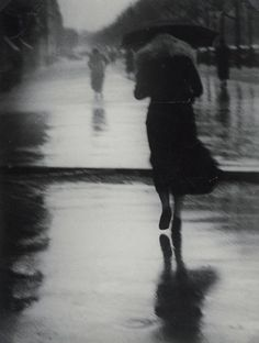 Brassaï 1899-1984  Passersby in the rain, 1935