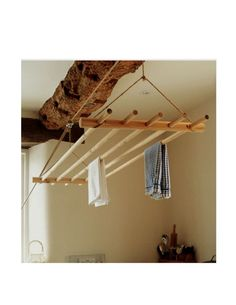 suspended laundry drying rack with pulleys. us an old ladder.: