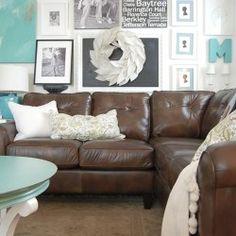Lighten up dark sofa...leather sofa w/ light color scheme