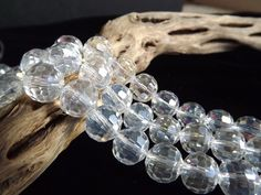 10mm Multi Faceted Glass Metallic Clear Disco Ball 8 Qty. $2.50, via Etsy.