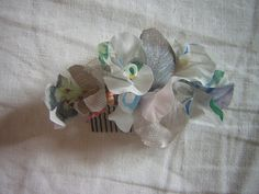 Hair combs made from vintage fabrics now avaliable on Etsy!