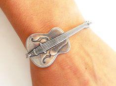 Steampunk Guitar Bracelet- Sterling Silver Ox. $20.00, via Etsy.