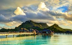 """Now this doesn't always happen, but it certainly did this time. I was lucky enough to be in Bora Bora for a week straight and got to see a week's worth of sunsets across this view. Amazing! But usually I am taking photos before the sunset, and when the sunset comes, I immediately """"upgrade"""" all the pre-sunset shots! - BORA BORA, FRENCH POLYNESIA - photo from #treyratcliff Trey Ratcliff at http://www.StuckInCustoms.com"""