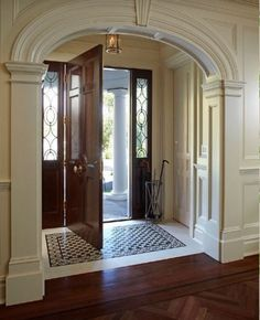 Traditional house entry. Marble and wood