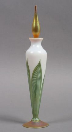 """Pretty art glass scent bottle with classic feather design signed 'L.C. Tiffany Favrile.' Ht: 10.5"""" Sold for $500 in 2012"""