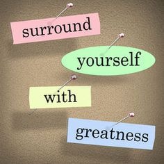 stock photo of motivation  - Surround Yourself with Greatness words in a saying or quote pinned to a bulletin board for motivation and inspiration - JPG
