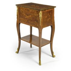 c1755 A Louis XV ormolu-mounted tulipwood, sycamore, fruitwood and marquetry table en chiffoniere circa 1755 Estimate 6,000 — 9,000 USD LOT SOLD. 5,625 USD (Hammer Price with Buyer's Premium)