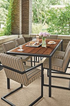 Ipe wood and steel combine to create a durable outdoor dining table. Outdoor Seating, Outdoor Dining, Outdoor Tables, Outdoor Spaces, Outdoor Decor, Ipe Wood, Modern Outdoor Furniture, Backyard, Patio