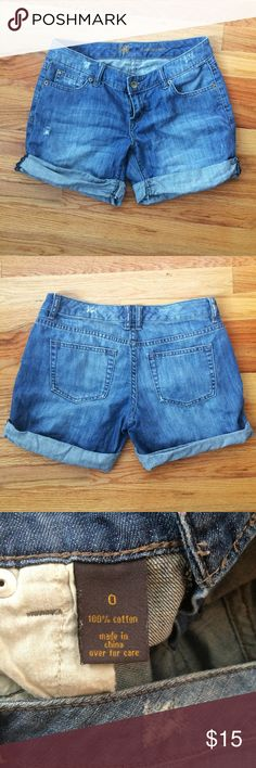 "Outback Red | Denim Cuffed Shorts The perfect pair of denim shorts! Cuffed denim shorts in a medium wash with some manufactured ""wear"" (like the small fraying/tear parts). Size zero but runs a little big! Outback Red Shorts Jean Shorts"