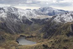 Ministry posted a photo:  It's easy to see why this beautiful bowl in the mountains is one of Snowdonia's main attractions for tourists, walkers/climbers and geologists/botanists.  The main path from Ogwen/Idwal Cottage enters the image at the lower left, meeting Llyn Idwal at its outflow, 2 km from here. From there, paths follow the left and right shores, as a popular circuit and as access to more ambitious climbing and walking routes not to be attempted in the jeans and trainers worn by…